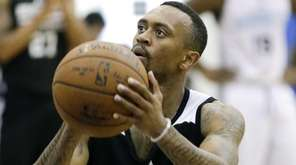 Brooklyn Nets' Ryan Boatright shoots against the Charlotte