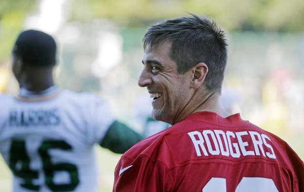 Green Bay Packers quarterback Aaron Rodgers smiles during