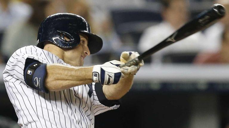 The New York Yankees' Brett Gardner hits a