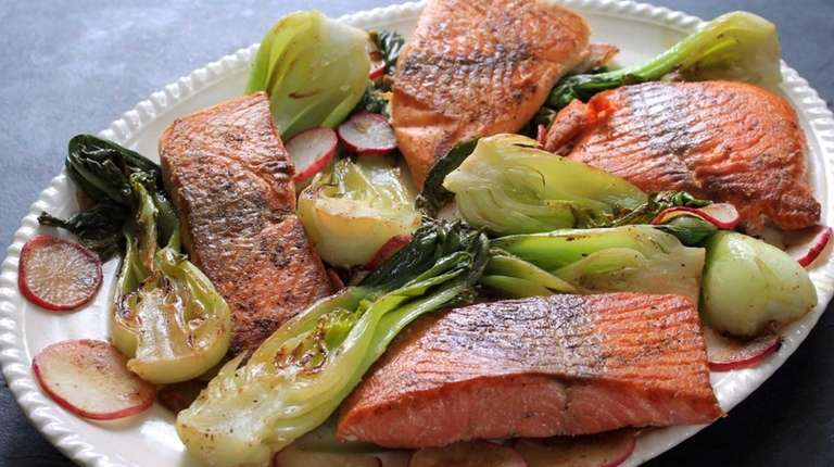 Salmon is seared on one side in a