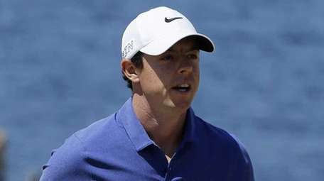 Rory McIlroy walks off the second green during