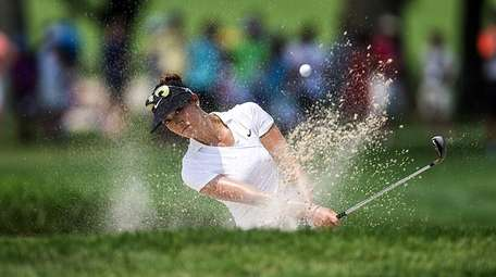 Michelle Wie hits out of a bunker on