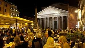 Ancient monuments, such as the floodlit facade of