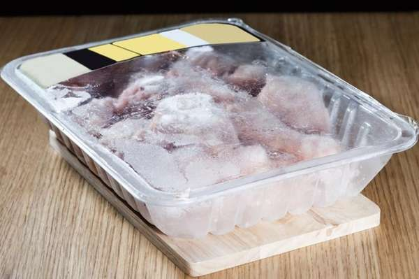 Package of frozen chicken.