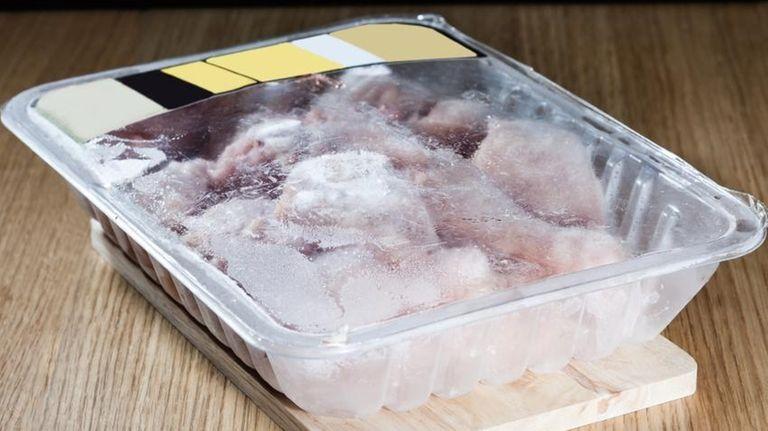 Package of frozen chicken.