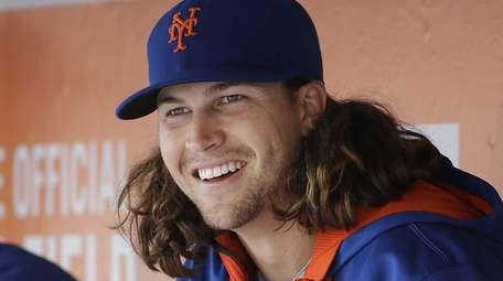 New York Mets pitcher Jacob deGrom smiles in