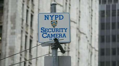 A sign explains that security cameras are being
