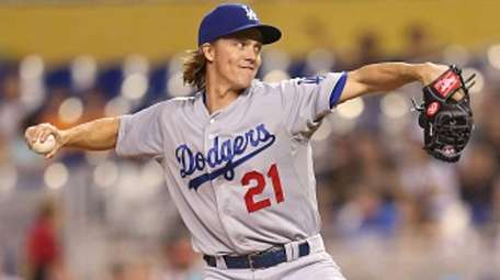 Zack Greinke of the Los Angeles Dodgers pitches