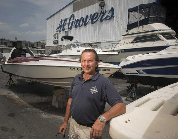 Dante Grover stands in the boatyard of Al