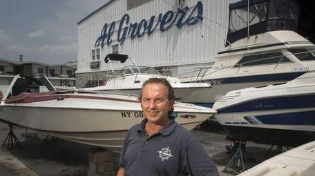 Dante Grover stands in the boatyard of Al