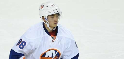 Islanders White Team defenseman Andong Song skates during
