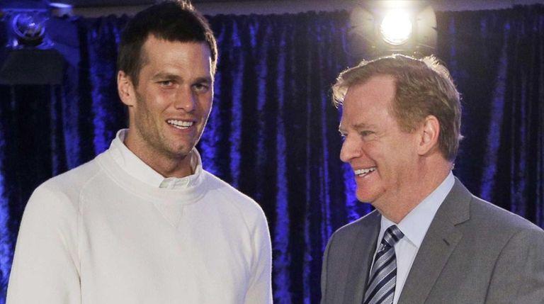 New England Patriots quarterback Tom Brady poses with