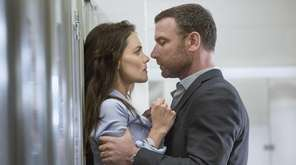 Katie Holmes as Paige and Liev Schreiber as