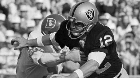 Oakland Raiders quarterback Ken Stabler looks for room
