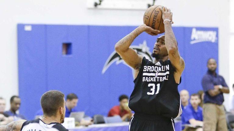 Brooklyn Nets' Ryan Boatright takes a shot over