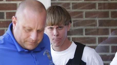 Charleston, S.C., shooting suspect Dylann Storm Roof, center,