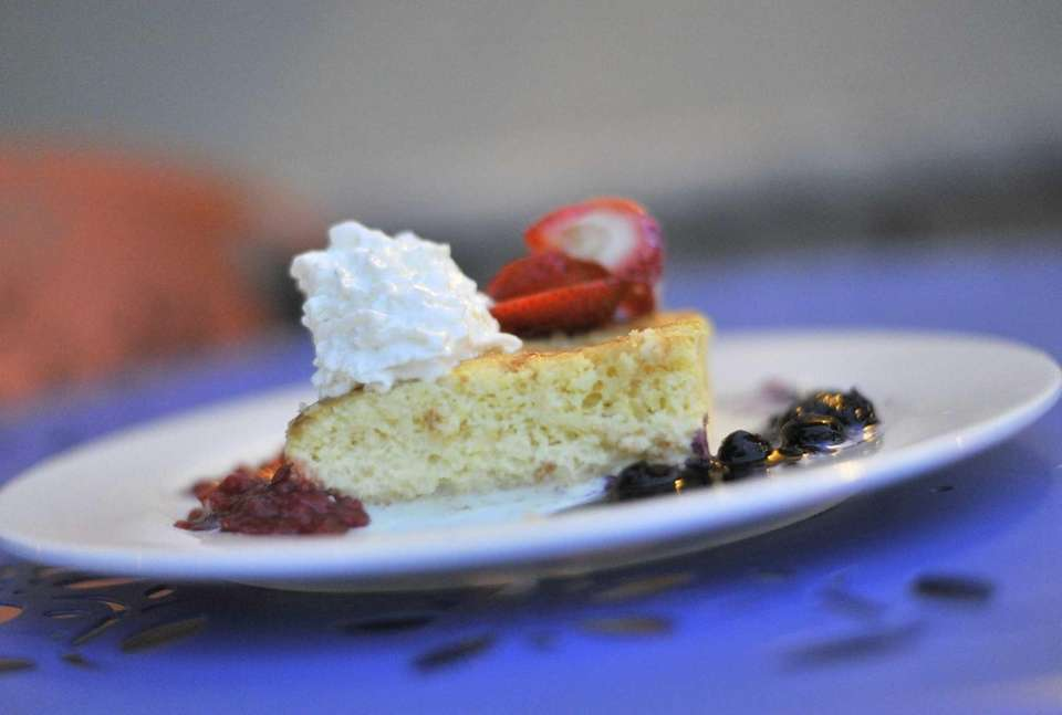 A plate of berry tres leche dessert is