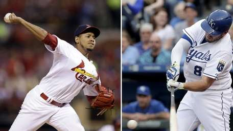 The St. Louis Cardinals' Carlos Martinez, left, and