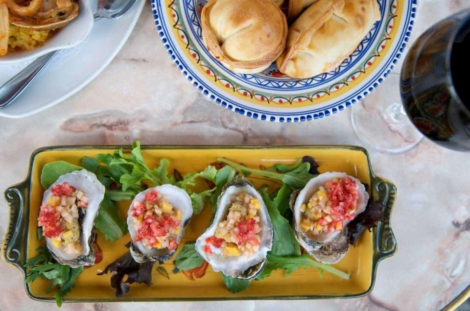 Oysters stuffed with spinach, mascarpone cheese, bacon and