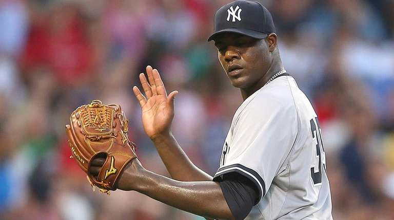 Michael Pineda #35 of the Yankees reacts after