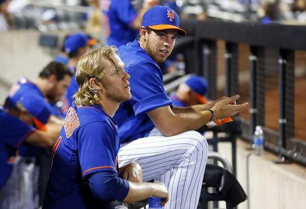 Noah Syndergaard #34 and Steven Matz #32 of