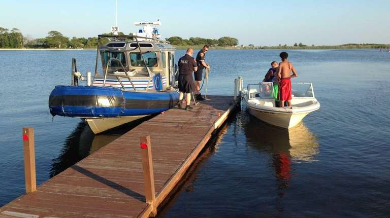 Suffolk Marine Bureau officers rescued three people from