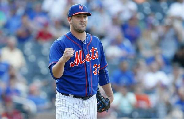 Matt Harvey of the Mets pumps his fist