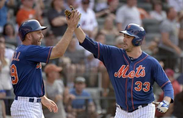 New York Mets' Matt Harvey, right, celebrates with