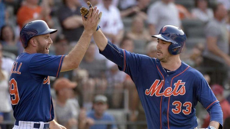 New York Mets' Matt Harvey, right, celebrates with
