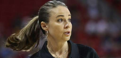 Becky Hammon coaches the San Antonio Spurs during