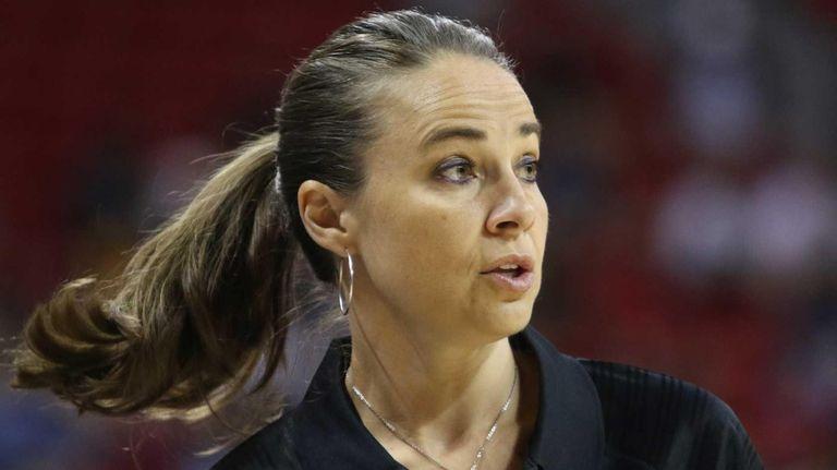 Becky Hammon coaches the San Antonio Spurs during