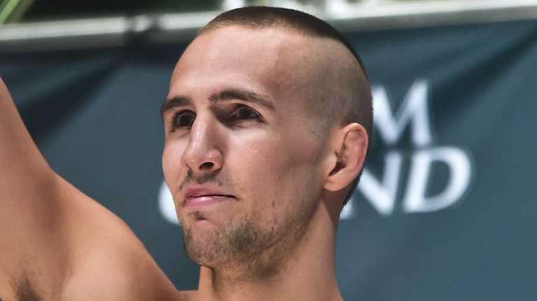 Welterweight fighter Rory MacDonald salutes the crowd during