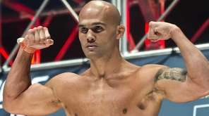 Welterweight Robbie Lawler flexes on the scale during