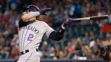 Troy Tulowitzki #2 of the Colorado Rockies hits