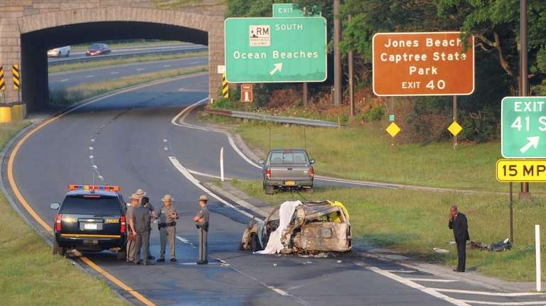 State Police troopers stand at the scene of