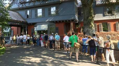 Visitors line up Sunday morning, July 12, 2015,