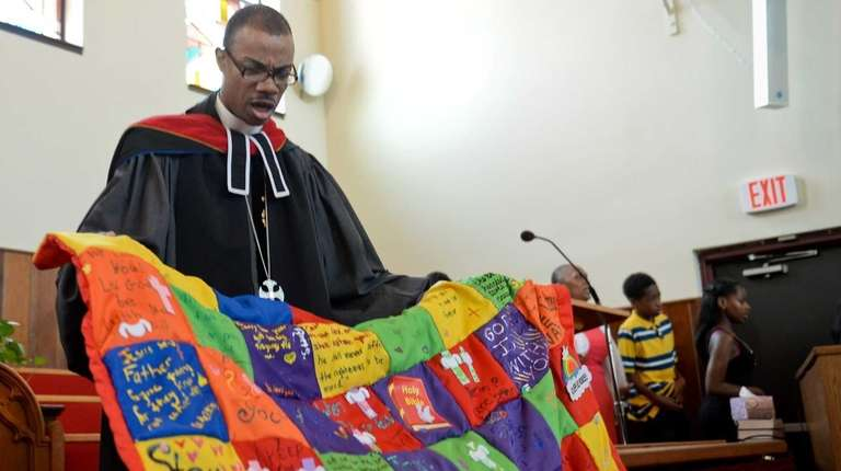 Rev. Malcolm J. Byrd presents the quilt to