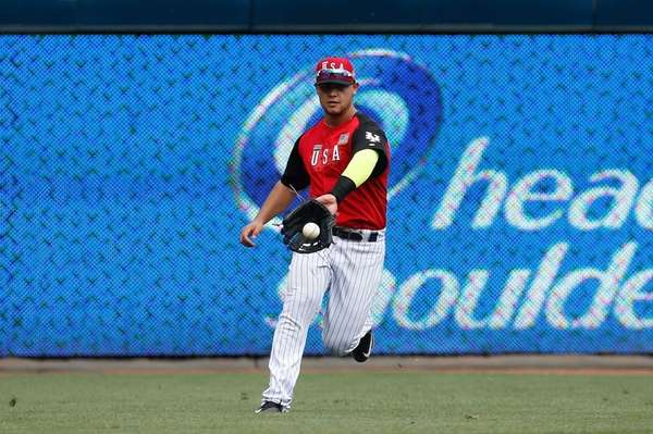 Michael Conforto #8 of the U.S. Team fields