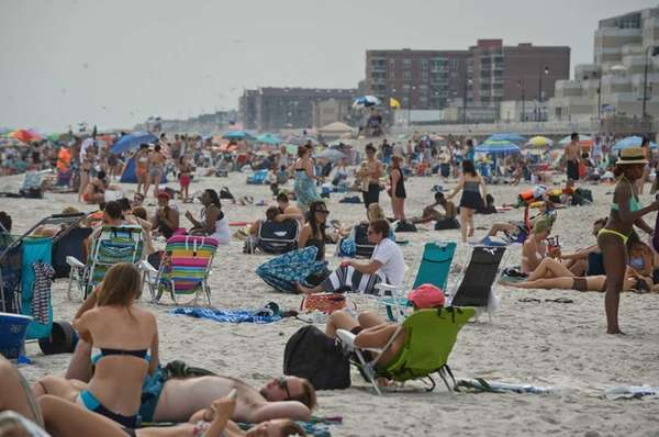 Beachgoers enjoy the water at Long Beach, Sunday,