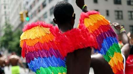 A participant wears multicolored wings while participating in