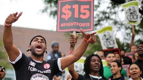 Members of the NYC Fast-Food Workers' Campaign rally