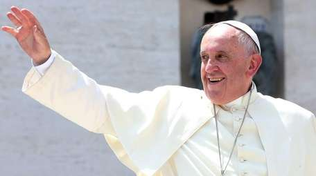 Pope Francis waves to the Boy Scouts gathered