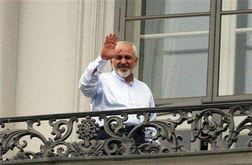Iranian Foreign Minister Mohammad Javad Zarif greets journalists