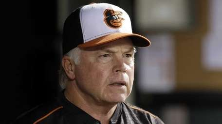 Baltimore Orioles manager Buck Showalter watches from the