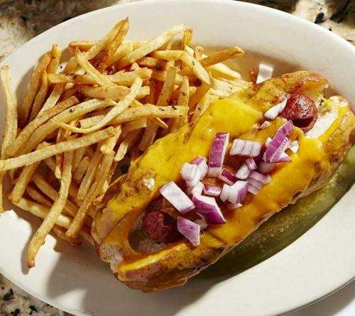 The Decadent Dog with cheese, red onion, and
