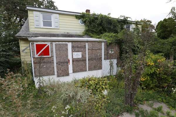 This board-up home sits in Levittown on Oct.