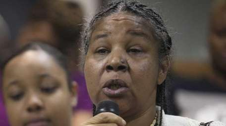 Esaw Garner, wife of Eric Garner, speaks alongside
