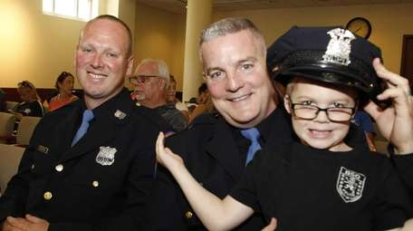 From left, Nassau Police Officer Robert Gibbons with