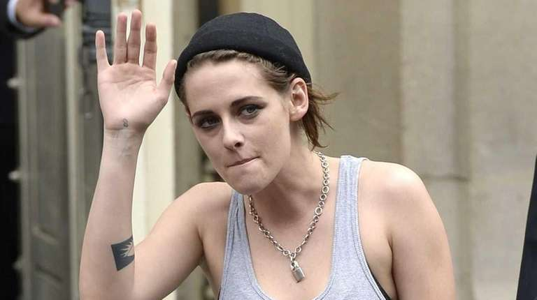 Actress Kristen Stewart greets fans as she leaves