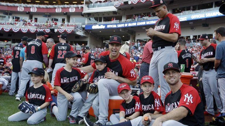 The American League's Brett Gardner, Mark Teixeira and